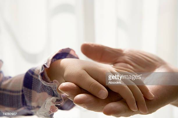 A man and a girl holding hands