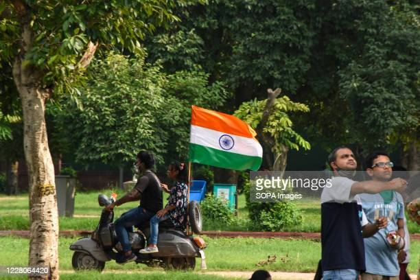 A man and a girl riding on scooter with an Indian flag during the occasion India celebrated its 74th Independence Day It is annually celebrated on...