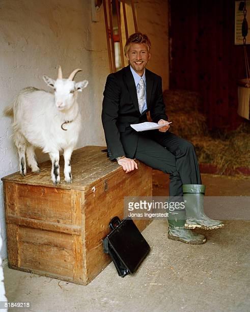 a man and a goat sweden. - bottes photos et images de collection