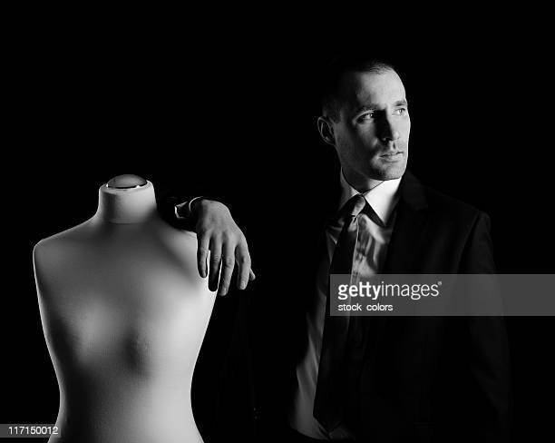man and a sewing mannequin