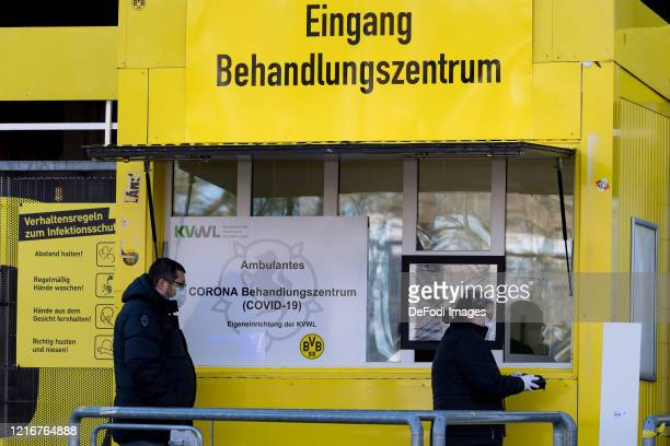 Man and a woman at the entrance to the Corona treatment center in the north stand area of ??the SIGNAL IDUNA PARK on April 4th, 2020 in Dortmund. The...