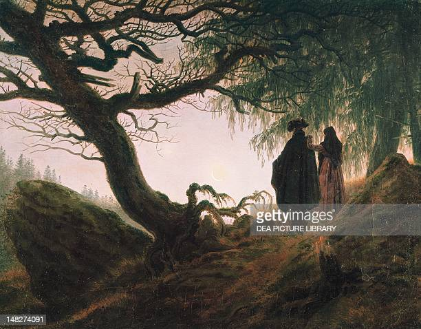 A man and a woman contemplating the moon by Caspar David Friedrich