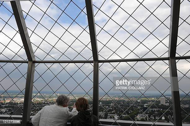 A man and a woman enjoy the general view of the city of Dortmund western Germany from the Florian TV tower at the Westfalenpark on August 16 2011 AFP...