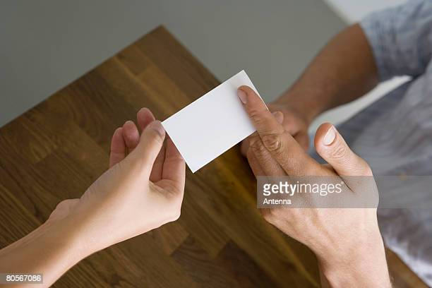 A man and a woman exchanging a business card