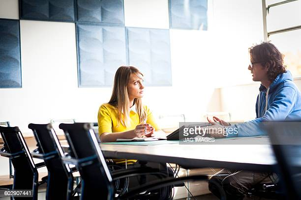 man and a woman have a business meeting