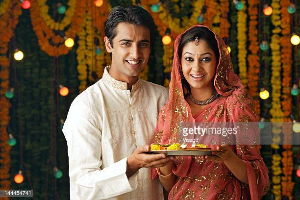 man and a woman holding pooja thali, diwali - diwali stock photos and pictures
