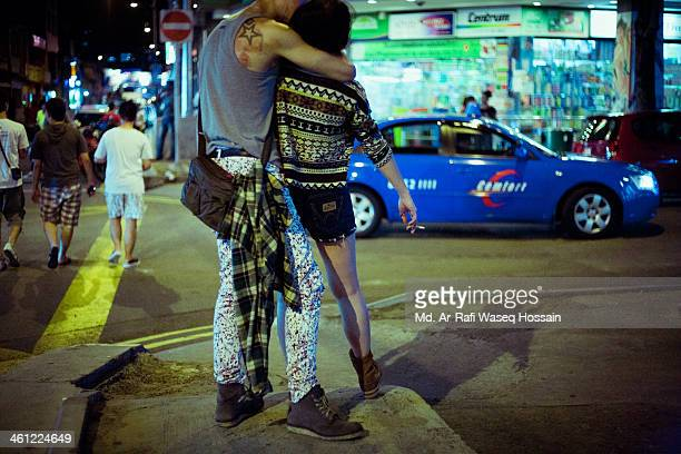 CONTENT] A man and a woman kissing on the street in Singapore Public Display of Affection Syed Alwi Road Singapore