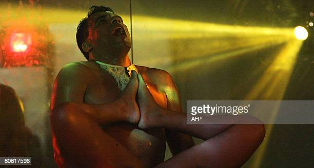 A man and a woman perform a show on April 19 2008 during the 12th Erotika Fair Latin America's biggest erotica trade show held at the exhibition hall...