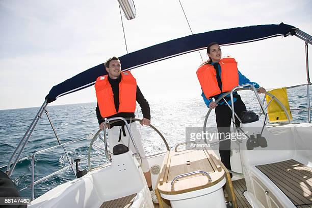 A man and a woman sailing