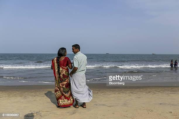 Man and a woman talk at Velankanni Beach in Nagapattinam, Tamil Nadu, India, on Saturday, Oct. 15, 2016. India's new central bank head seems to be...