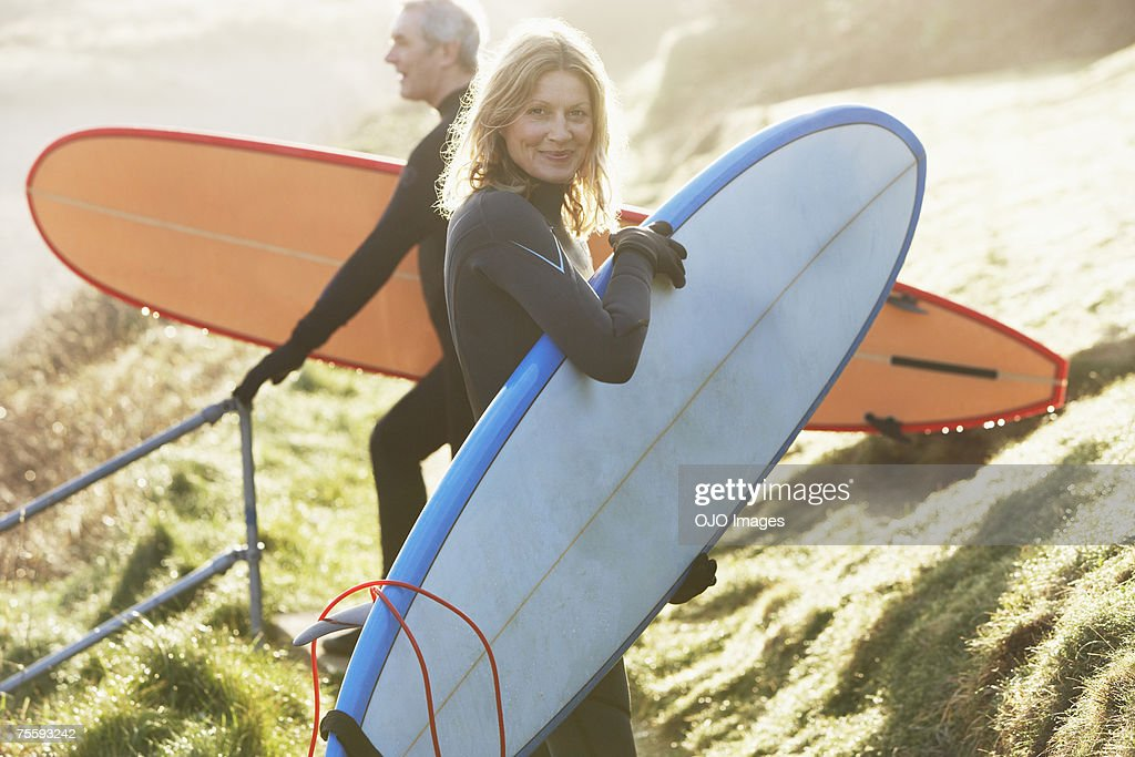 A man and a woman with surfboards : Stock Photo