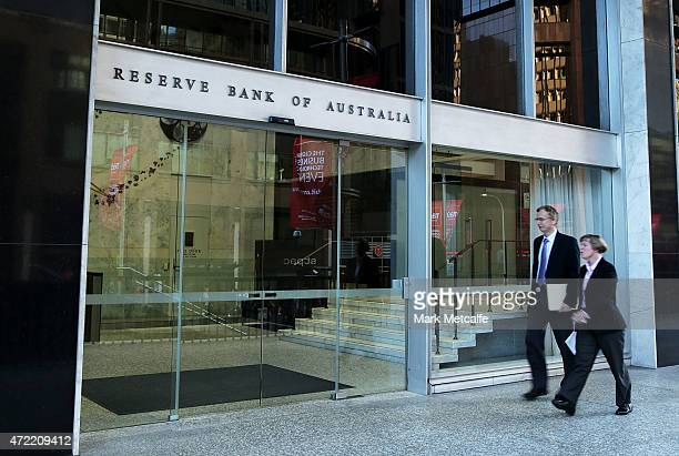 A man and a women walk into the Reserve Bank of Australia headquarters on May 5 2015 in Sydney Australia Forecasters are predicting the Reserve Bank...