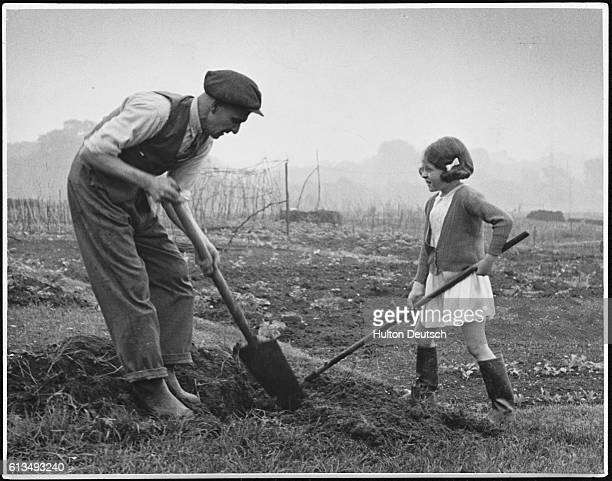 Man and a young girl at work on an allotment on Hampstead Heath during the Second World War.