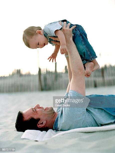 man and baby on beach