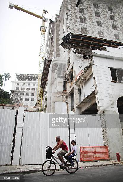 A man and boy bicycle beneath the 91yearold Gloria Hotel which remains only partially restored by REX part of Eike Batista's EBX Group Co on October...