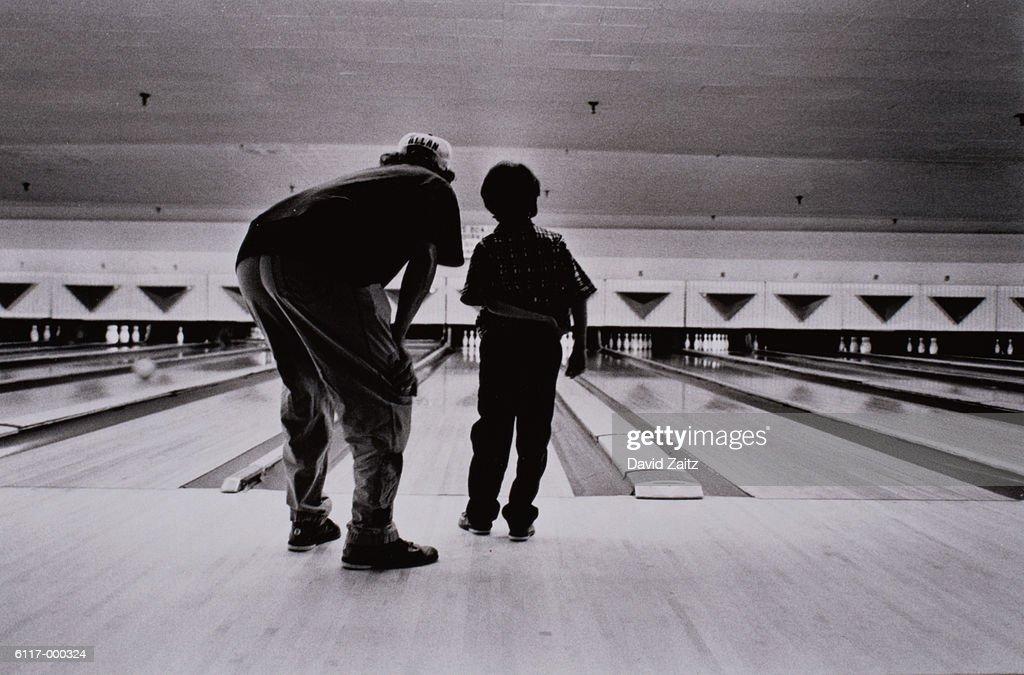 Man and Boy Bowling : Stock Photo