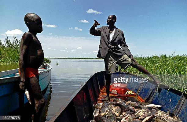 Man and boy from the Mundari tribe are pictured with their catch in Terekeka, a fishing community 75km north of Juba in South Sudan, on September 17,...