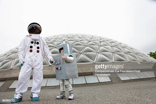 man and boy in costumes by biosphere