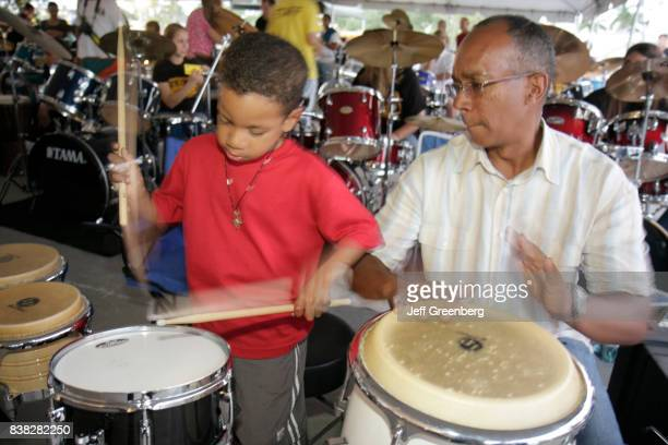 A man and boy playing the drums at The Big Beat event
