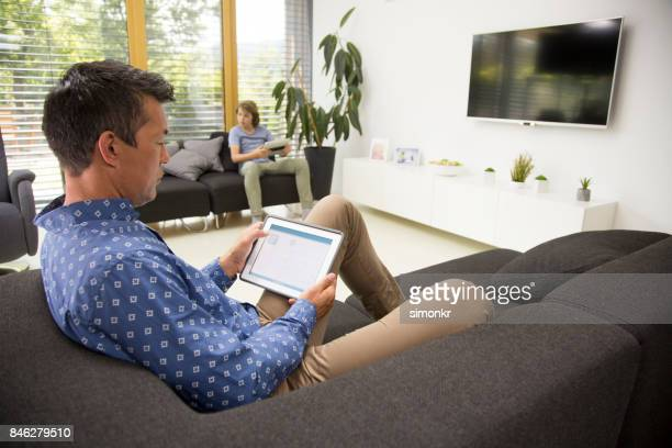 Man and boy using digital tablet