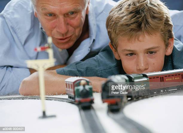 Man and Boy with Toy Trains
