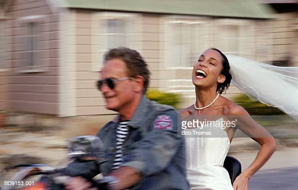 man and bride on motorcycle (focus on bride) - may december romance stock photos and pictures
