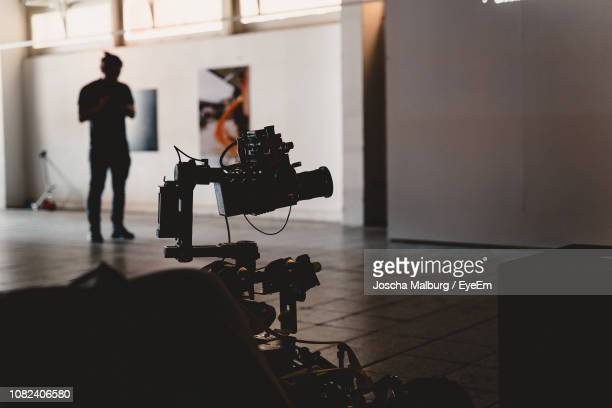 man and camera on stage - behind the scenes stock pictures, royalty-free photos & images