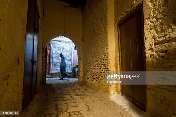 Man and Carpet on Islamic Street