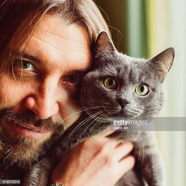 Man and cat looking at camera