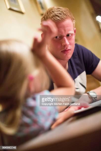 man and child at a restaurant - kraków ストックフォトと画像