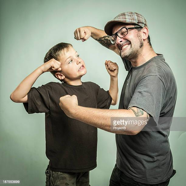 Man and child play fighting
