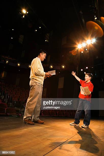 man and child practicing a play - rehearsal stock pictures, royalty-free photos & images