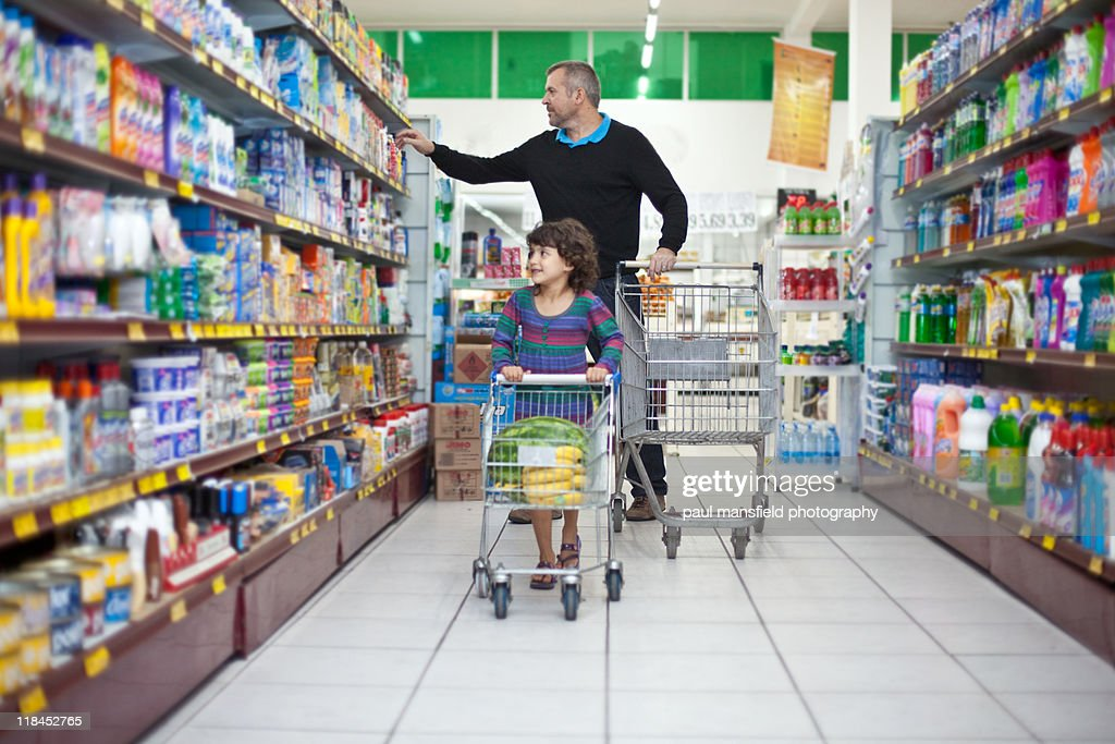 Man and child shopping at supermarket : Stock Photo