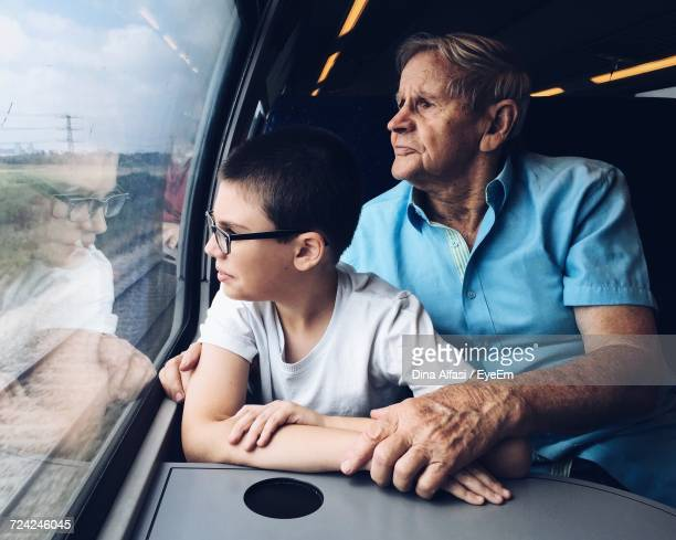 Man And Child Traveling By Train