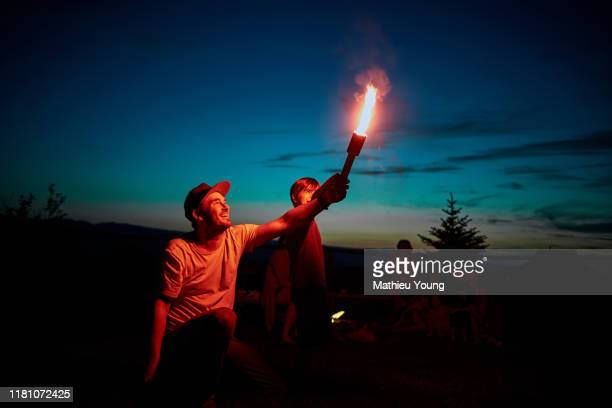 Man and child with firework