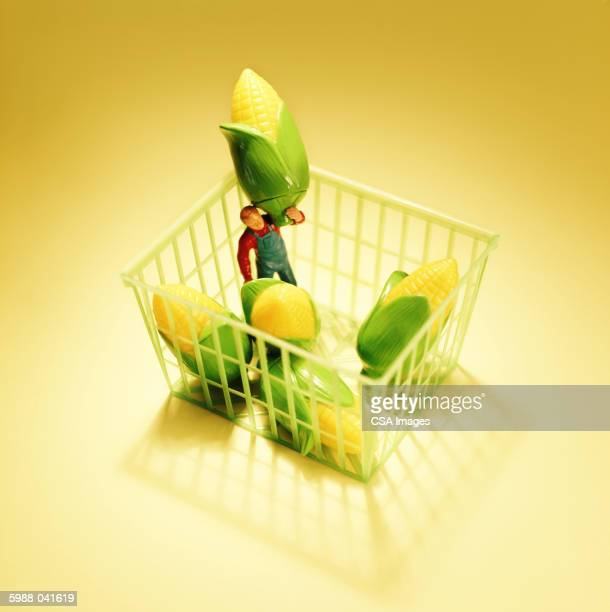 Man and Corn in Pint Basket