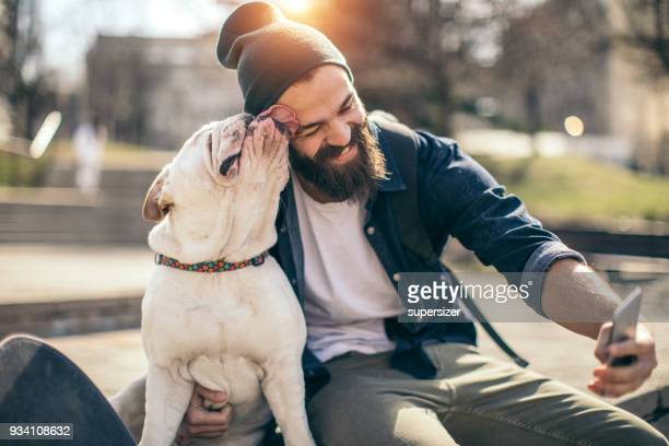 man and dog in the park - dog stock pictures, royalty-free photos & images