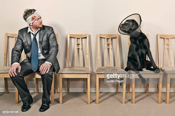 Man and Dog in Waiting Room