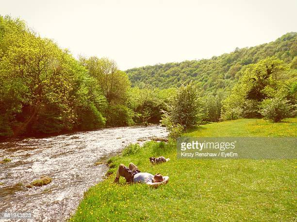 Man And Dog Relaxing By A River