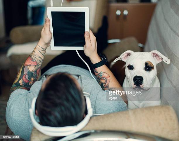 Man and dog using tablet.