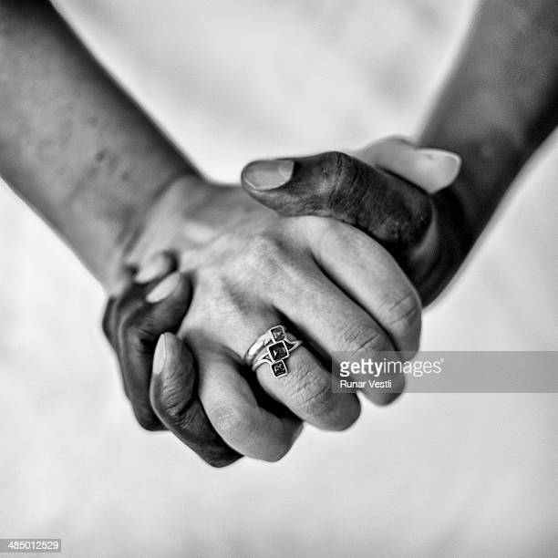 Man and female holding hands
