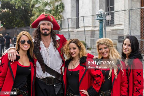 a man and four women wearing costumes in the street during the mardi gras celebration at new orleans carnival, louisiana, usa. - mardi gras fun in new orleans stock photos and pictures