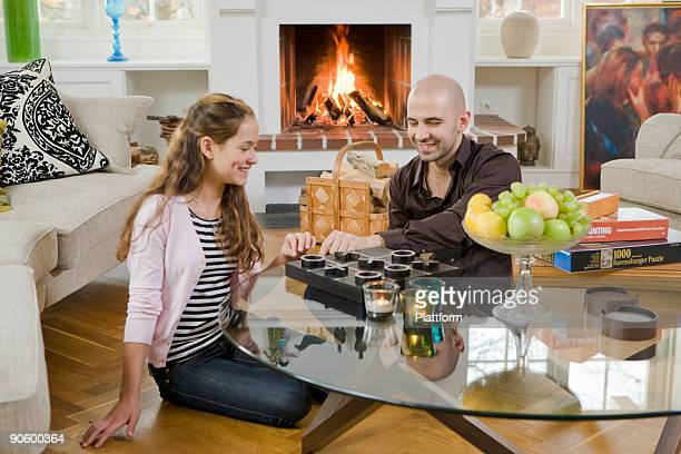 Man and girl at home playing a parlour game Sweden.