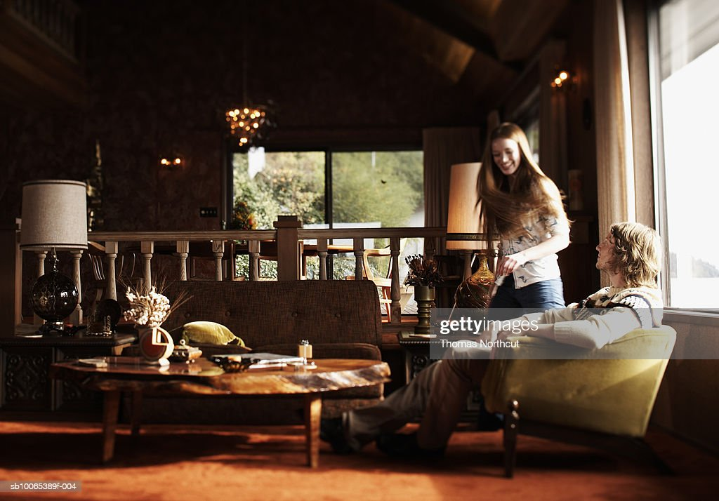 Man and girl (14-15) in room : Stock Photo