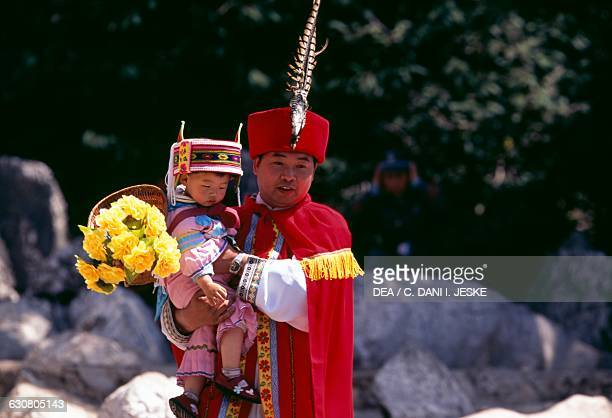 A man and girl in traditional costume Lunan Stone Forest Lunan Yunnan China