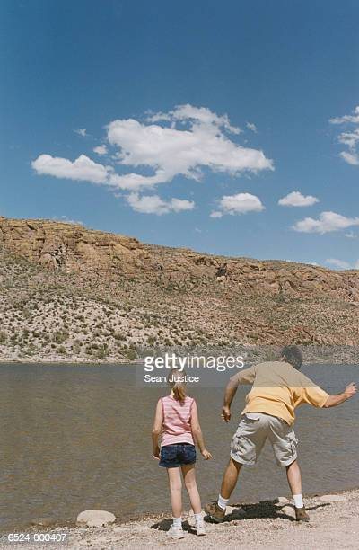 Man and Girl Skipping Stones