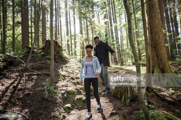 man and girl walking on the trail - travel stock pictures, royalty-free photos & images