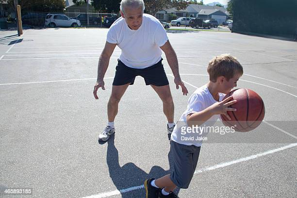 Man and grandson playing basketball