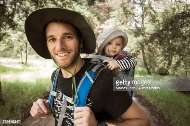 man and his baby girl at hiking trail in rancho santa elena, hidalgo, mexico - mexican and white baby stock photos and pictures