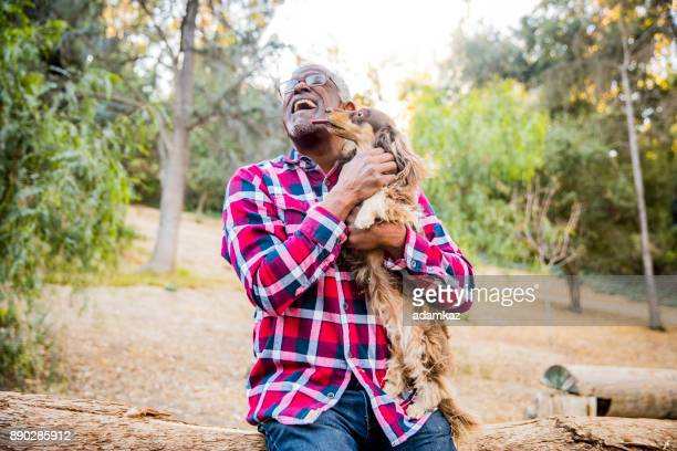 man and his best friend - black people kissing stock pictures, royalty-free photos & images